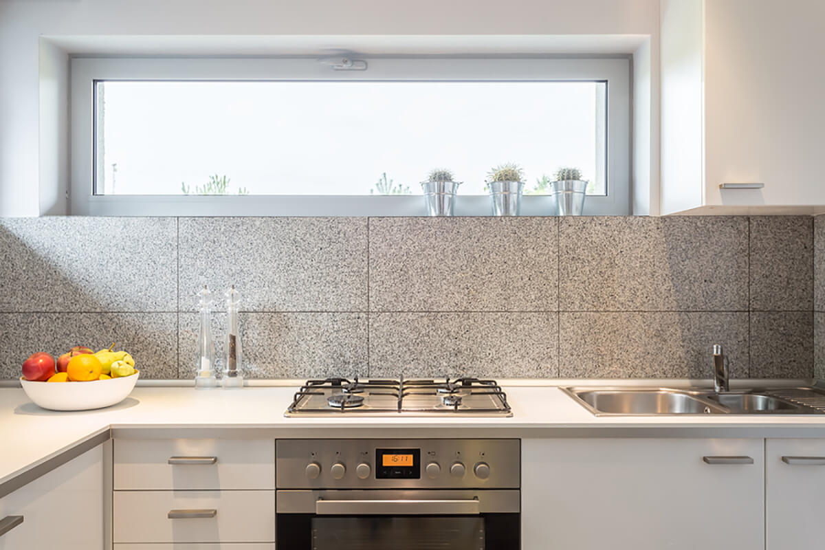 Kitchen with Natural Stone Backsplash