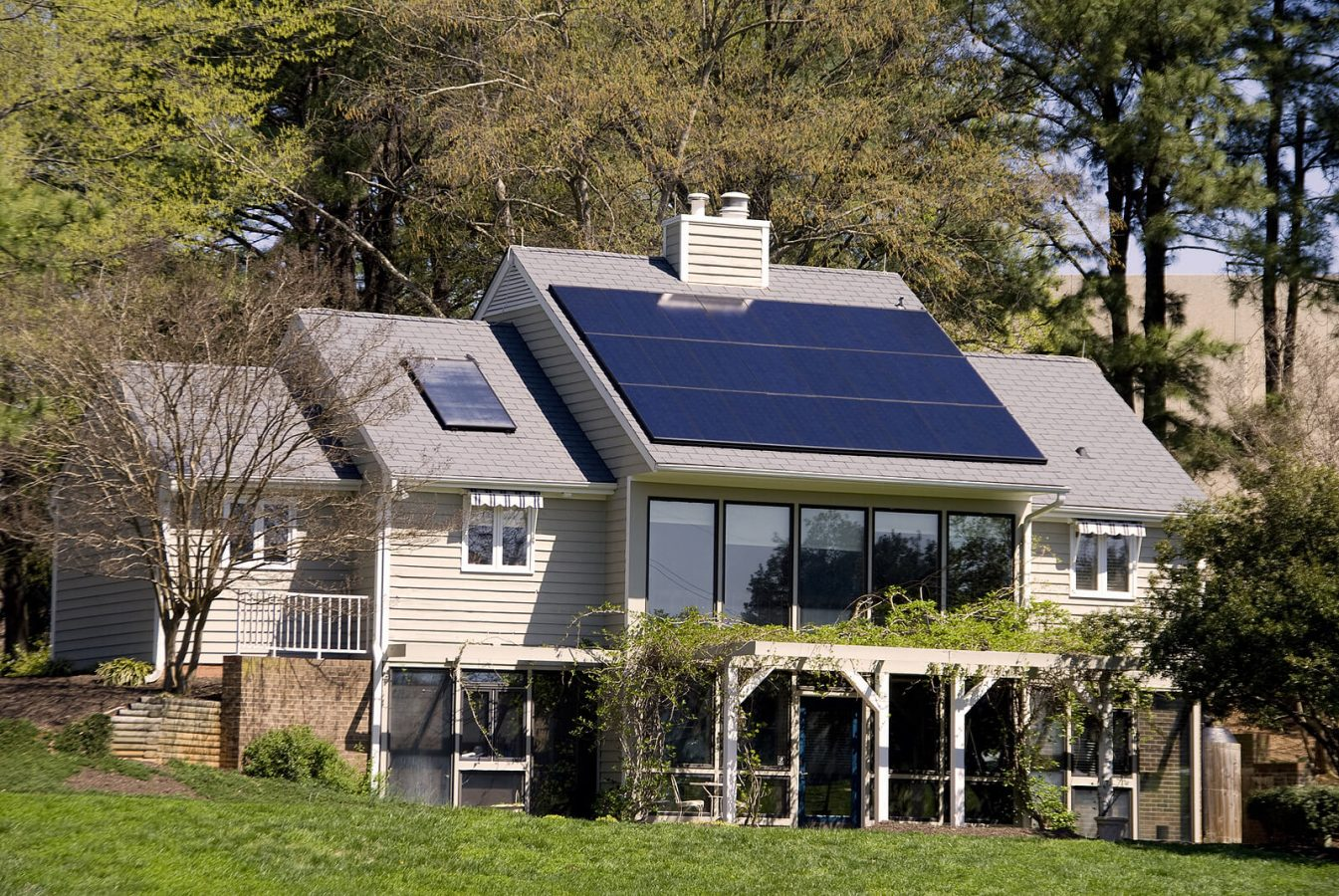 cottage with solar panels