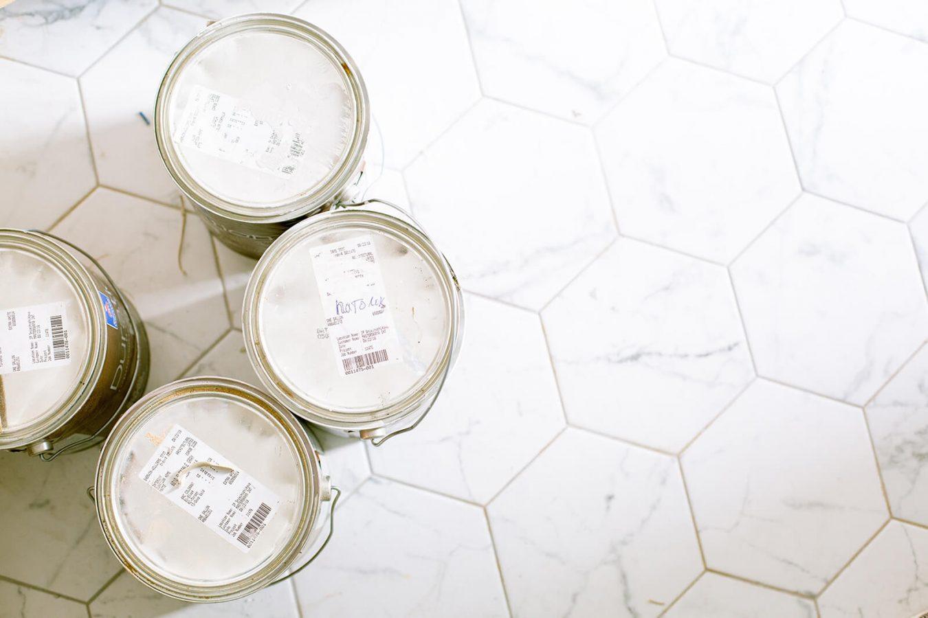 paint buckets on the kitchen floor